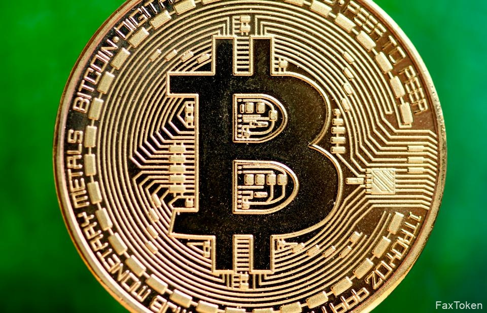 Bitcoin, a digital currency, is against a green background.