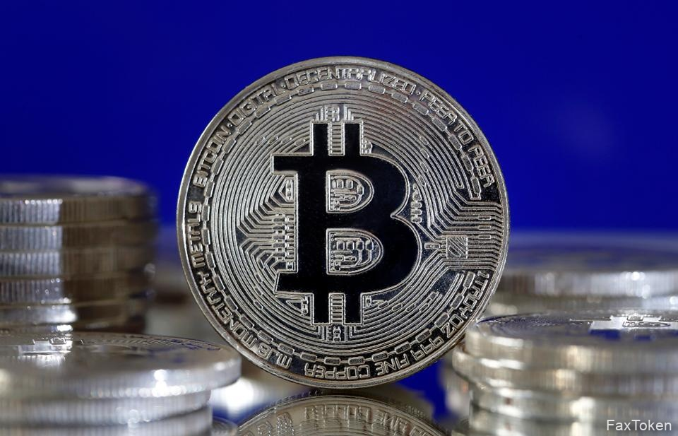 Bitcoin, a virtual currency, displayed against a blue background.